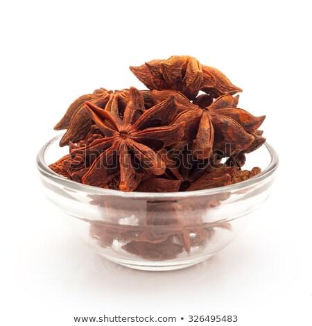 front view of bowl of organic star anise stock photo © ziprashantzi
