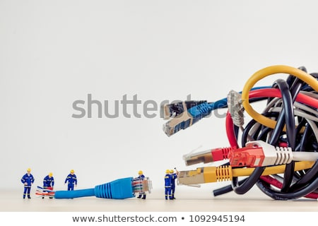 team of technicians connecting network cable stock photo © kirill_m
