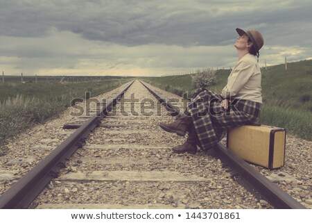 woman sitting on railway tracks stock photo © zurijeta