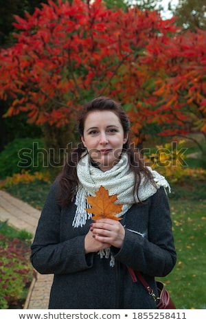 Young woman drying her long dark brown hair Stock photo © dash