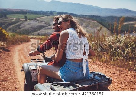 женщину вождения велосипедов лет области смеясь Сток-фото © Kzenon