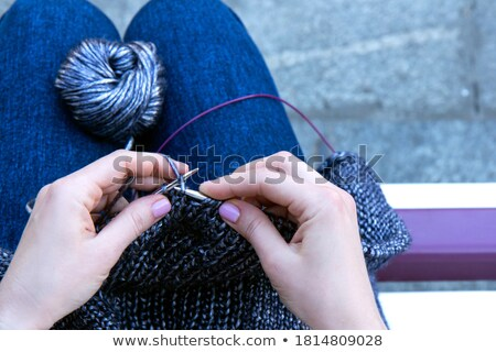 Craftswoman on her knees Stock photo © kalozzolak