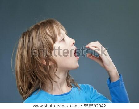 Fiú eszik valami láthatatlan kéz arc Stock fotó © courtyardpix
