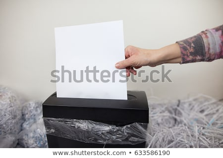 Close-Up Of An Overflowing Paper Shredder Stock photo © monkey_business