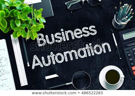 Black Chalkboard with Business Automation. 3D Rendering. Stock photo © tashatuvango