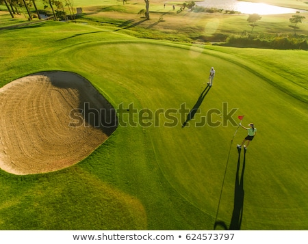 Woman in golf bunker Stock photo © IS2