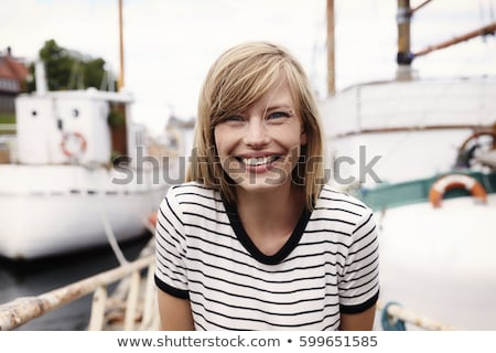 young woman portrait smiling on boat stock photo © is2