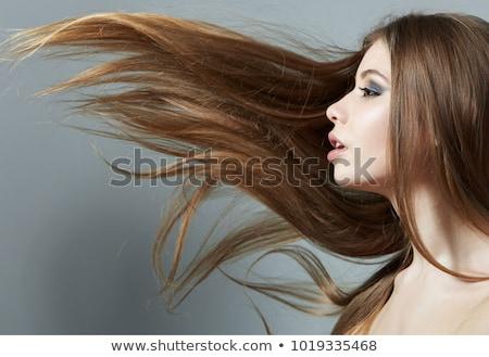 Blolnde with flying hair Stock photo © Pilgrimego