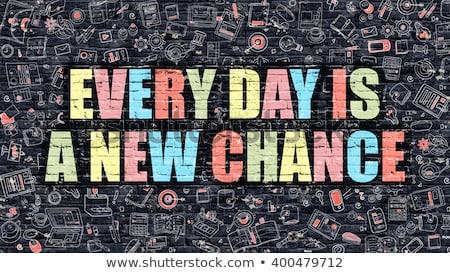 Every Day is a New Beginning on Dark Brick Wall. Stock photo © tashatuvango