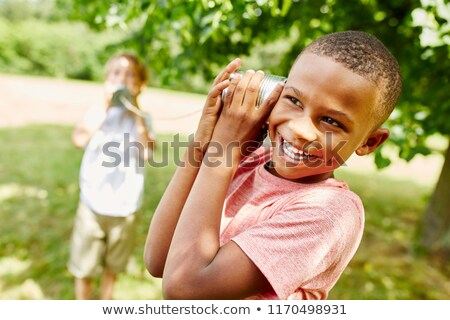 young boy playing with can phone stock photo © is2