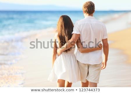 yandan · görünüş · çift · plaj · kadın - stok fotoğraf © is2