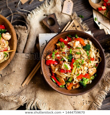 Two Bowls Of Pork And Broccoli Stir Fry Stock photo © mpessaris