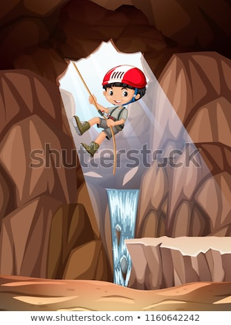 Boy abseiling into cave Stock photo © bluering