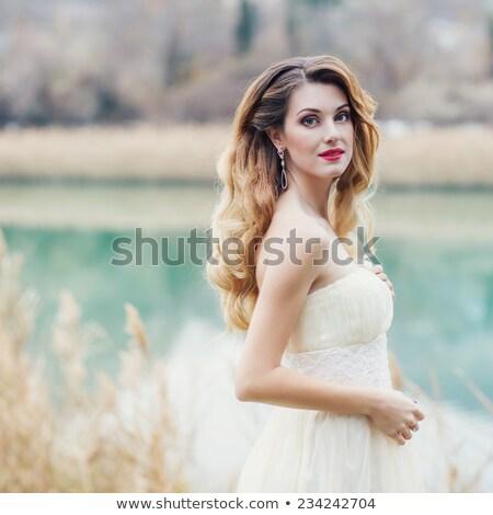 Mooie meisje meer cute groene tuin Stockfoto © alexaldo