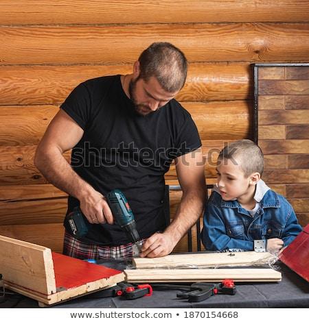 Feliz pequeno menino martelo oficina Foto stock © dolgachov