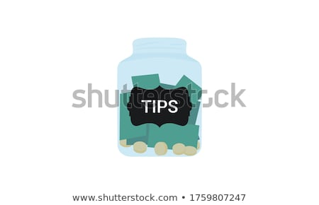 Isolated jar filled with coins labeled Charity Stock photo © Zerbor
