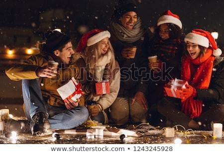 gelukkig · jonge · vrienden · vergadering · buitenshuis · avond - stockfoto © deandrobot