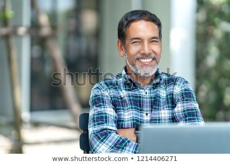 Retrato hispânico homem parede tijolo pessoa Foto stock © feverpitch