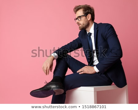 portrait of pensive businessman in navy suit looking to side Stock photo © feedough