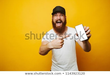 portrait of an excited young bearded man standing stock photo © deandrobot