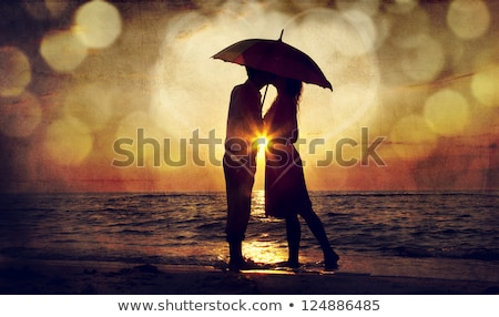 Stock photo: portrait of a young couple with umbrella