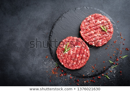 Fresh raw butchers lamb beef cutlets on chopping board with vintage meat hatchet and hammer on woode Stock photo © DenisMArt