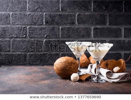 Kokosnoot martini cocktail donkere glas bar Stockfoto © furmanphoto