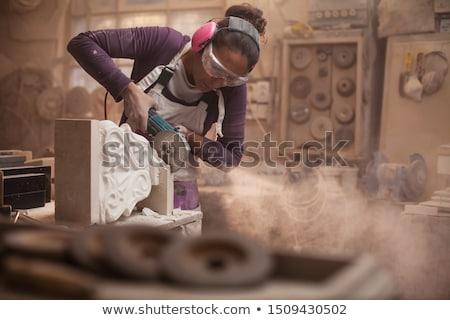 Stonemason cutting marble with angle grinder Stock photo © Kzenon