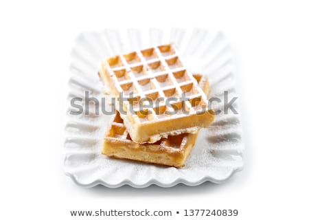 Belgium waffer on ceramic plate isolated on white background. Stock photo © marylooo