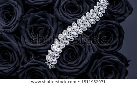 Luxury diamond jewelry bracelet and black roses flowers, love gi Stock photo © Anneleven