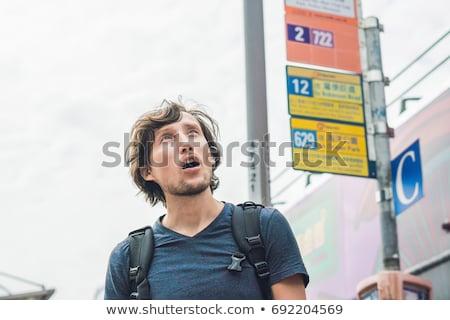 A man lost in Hong Kong. Buses in hong kong Stock photo © galitskaya