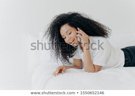 женщину вьющиеся волосы приятный телефон Сток-фото © vkstudio
