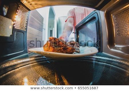 男 電子レンジ オーブン 若い男 キッチンカウンター ストックフォト © AndreyPopov