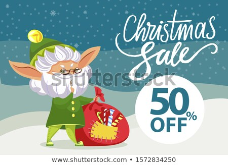 Christmas Sale, Elf with Sack of Gifts in Forest Stock photo © robuart
