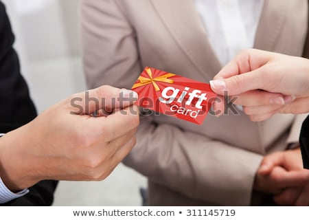 Ręce gift card inny strony Zdjęcia stock © AndreyPopov