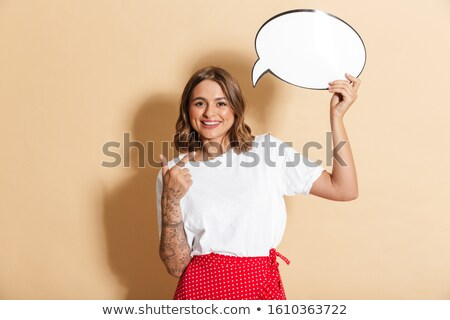 Image of pretty woman pointing finger at blank thought bubble Stock photo © deandrobot
