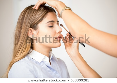 The woman getting her make-up done in beauty salon Stock photo © Elnur
