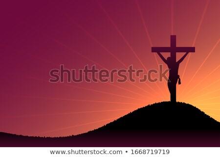 jesus christ crucifixion scene on dusk and sun rays Stock photo © SArts