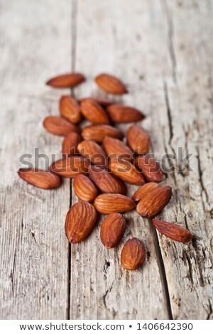 Fresco orgânico amêndoa sementes mesa de madeira Foto stock © marylooo