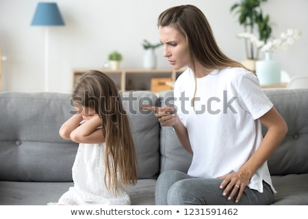 Stock photo: rebellious child fingers in ears