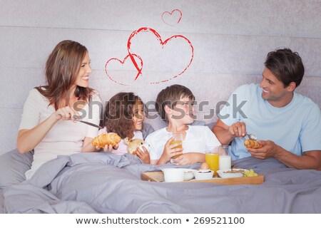 Сток-фото: молодым · человеком · завтрак · кровать · комнату · отель · чай