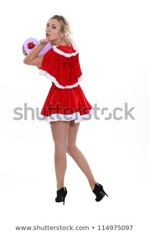 Cheeky Miss Santa looking over her shoulders Stock photo © photography33