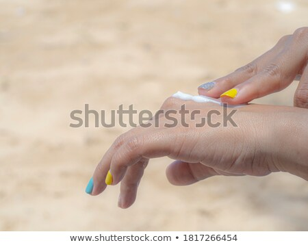 woman with a sun painted on her back stock photo © dash