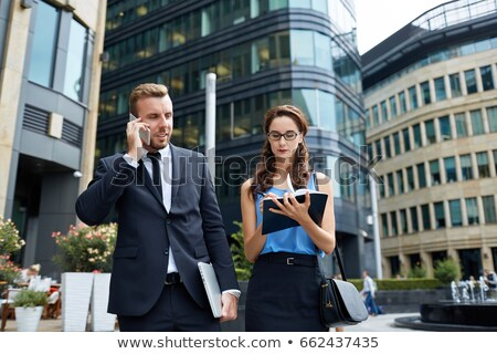 a manager at phone and his assistant Stock photo © photography33