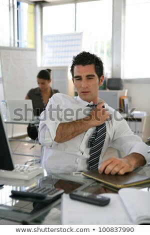 Man sat in office adjusting his tie Stock photo © photography33