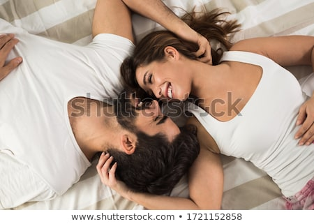 Happy couple resting in bed stock photo © wavebreak_media