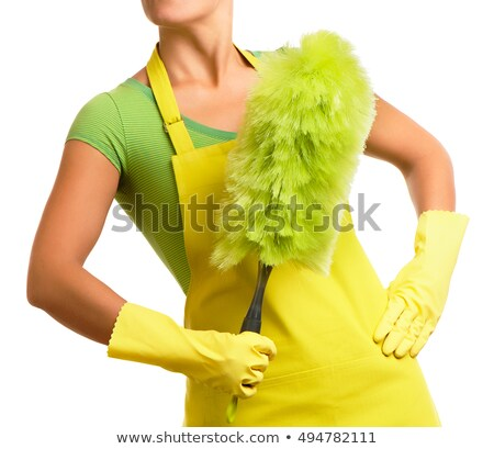 Woman in green with a feather duster Stock photo © photography33