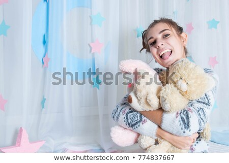 Woman hugging cuddly toy Stock photo © photography33