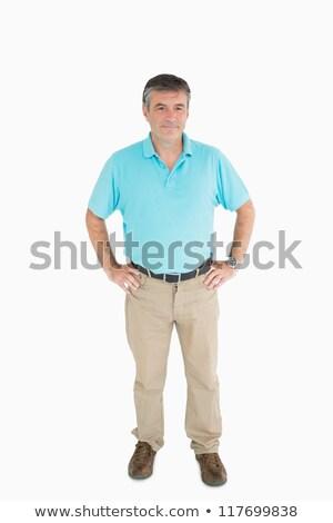 Sorridere uomo mani fianchi indossare casuale Foto d'archivio © wavebreak_media