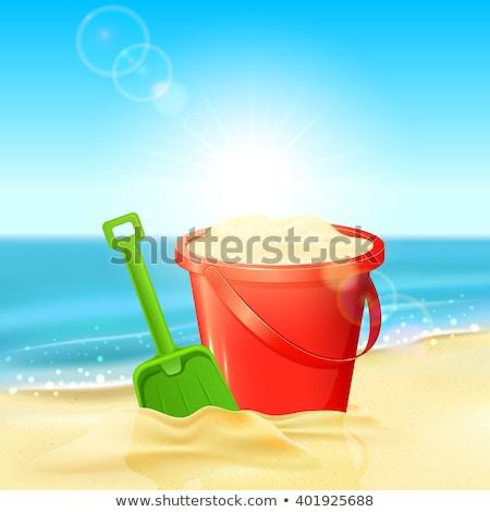 Sandcastle and shovel at the beach Stock photo © elxeneize